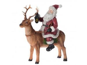 Χριστουγεννιάτικος επιτραπέζιος Άγιος Βασίλης σε Τάρανδο 17 x 19 εκ.